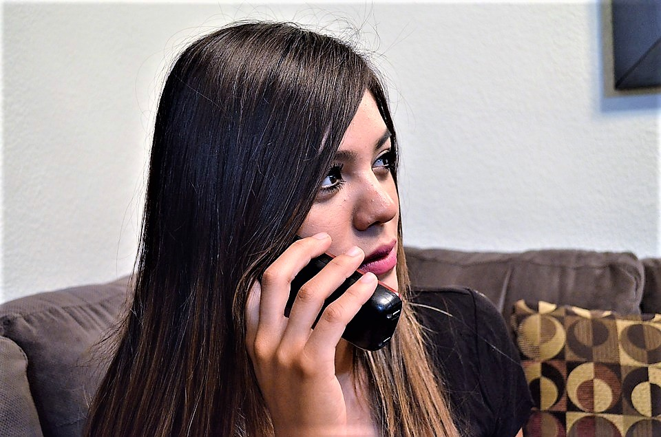 woman on telephone nuisance call