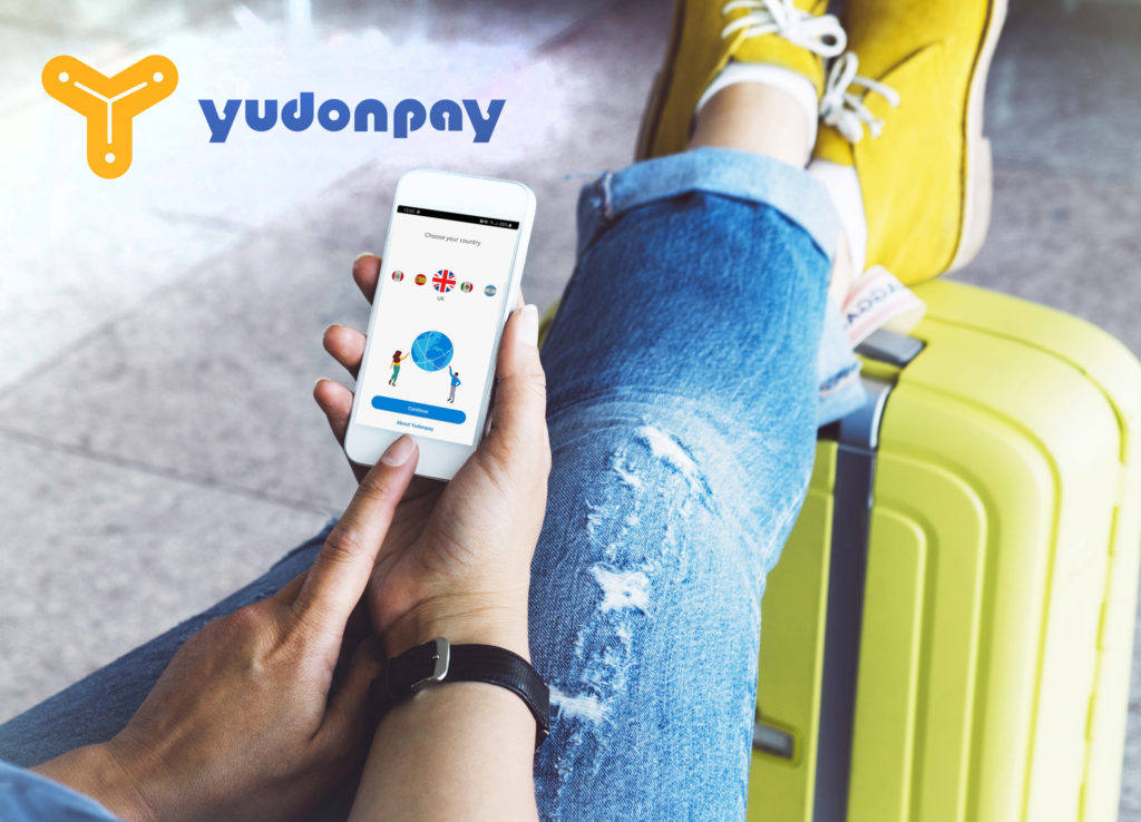 traveller with feet on suitcase using mobile phone